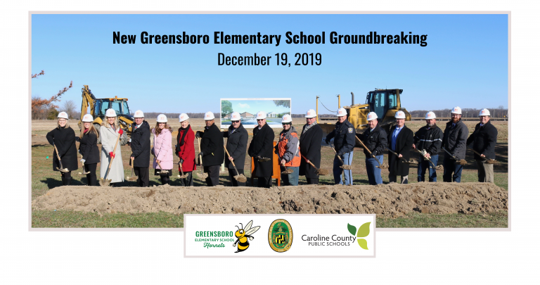 school and county officials putting shovels into ground