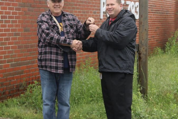 VFW Member hands the keys to CCPS Administrative Superintendent Milton Nagel