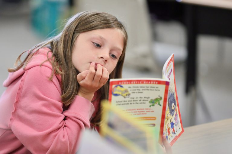 young student reading a book