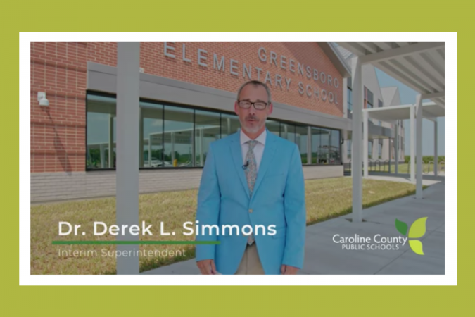 Dr. Simmons in front of Greensboro Elementary