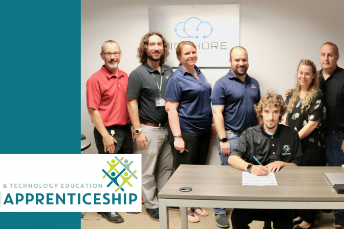 Student and Adults signing apprenticeship agreements